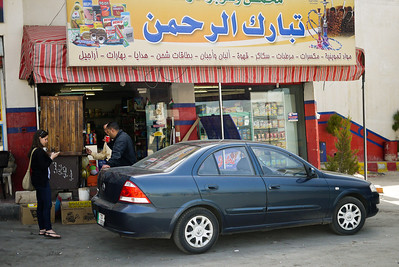 Parked and waiting for coffee at a shop in Jordan