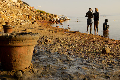 Sunset and clay pots of mud the Dead Sea from Jordan