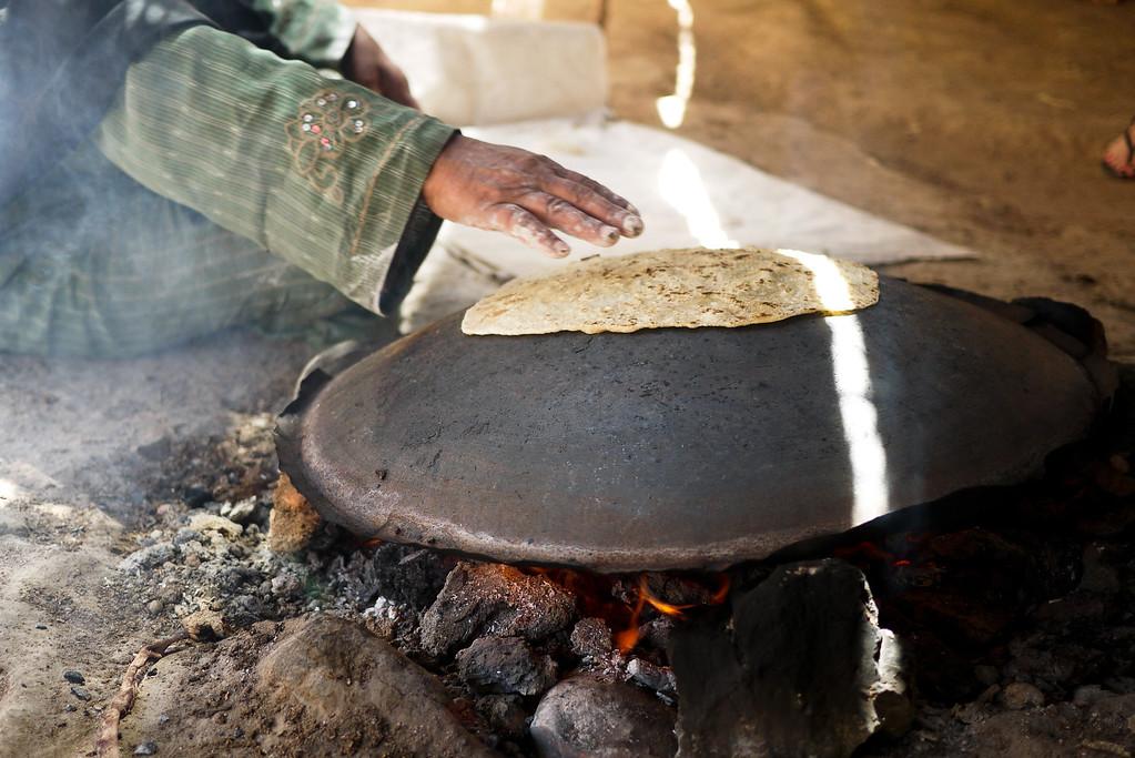 Making fresh shrak, a type of bread on the saj near the Feynan Ecolodge in Wadi Feynan, Jordan
