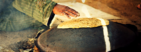 Making fresh shrak, a type of bread on the saj near the Feynan Ecolodge in Wadi Feynan, Jordan