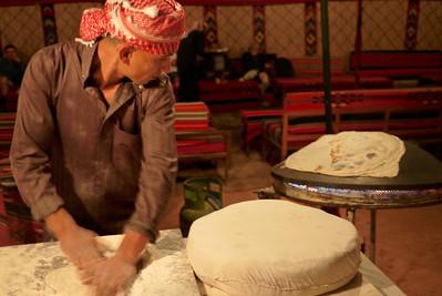 A Bedouin man making bread in Wadi Rum, Jordan