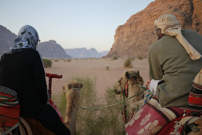 A quiet moment at sunrise to watch the rising playout a riot of subdued colors over Wadi Rum Desert, Jordan