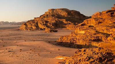 The Wadi Rum Desert tinted orange as the sunsets, Jordan