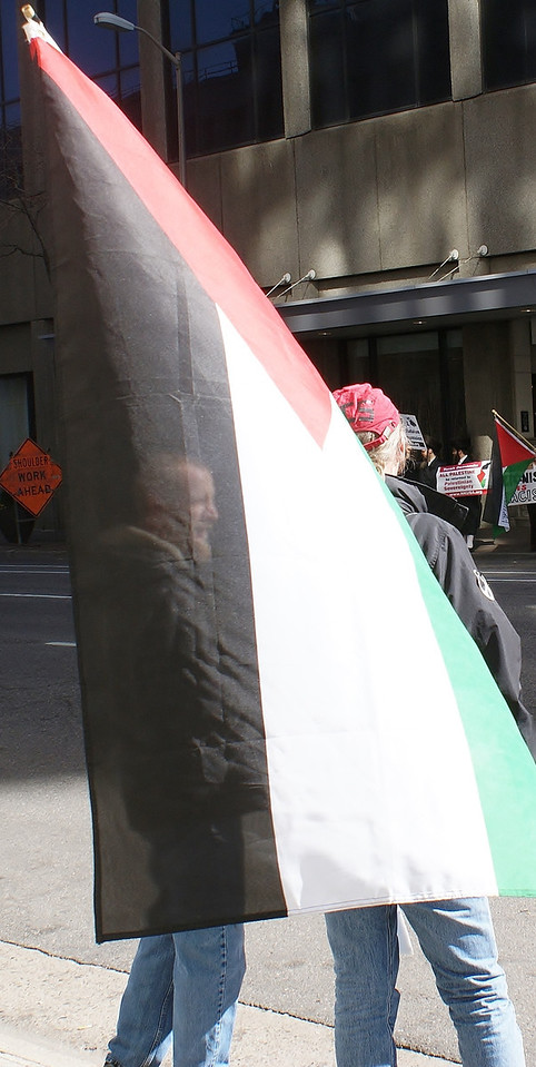 Demonstrators ouside a meeting of the Jewish National Fund in Denver, display the Palestinian flag.