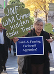 About 150 people marched through downtown Denver, to protest a meeting of the Jewish National Fund. (10/26/13)