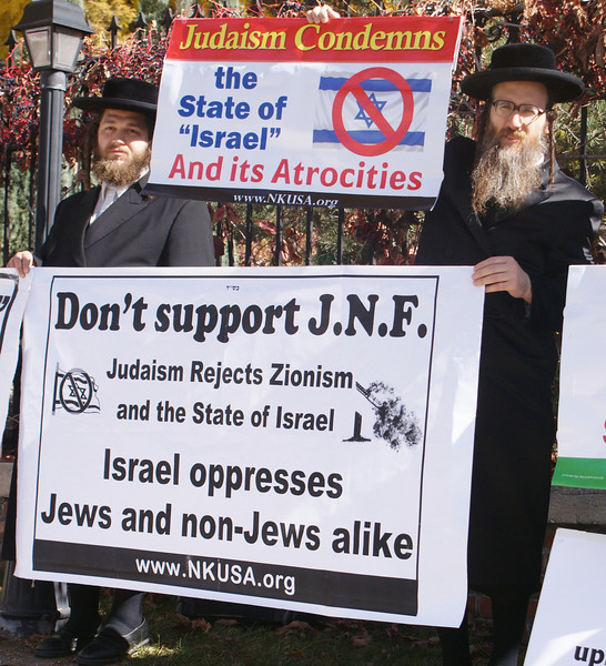 Orthodox Jews, members of Neturei Karta, were among the approximately 150 people who protested against the Jewish National Fund in Denver. The JNF was holding a 4 day conference, Oct 25-28.