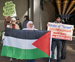 Demonstrators gather outside a downtown Denver hotel where the Jewish National Fund was holding a 4 day conference. Many displayed the Palestinian flag.