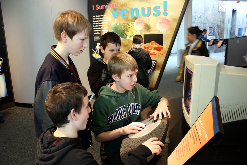 A gaggle of students try to figure out the orbits of planets