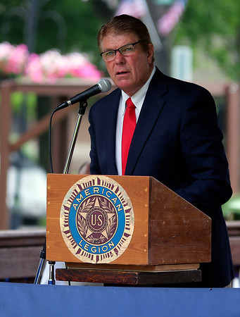 JOHN KLINE | THE GOSHEN NEWS<br /> Retired educator Mitch Miller provides the keynote address during the Memorial Day service at Memorial Park in downtown Middlebury Monday morning.