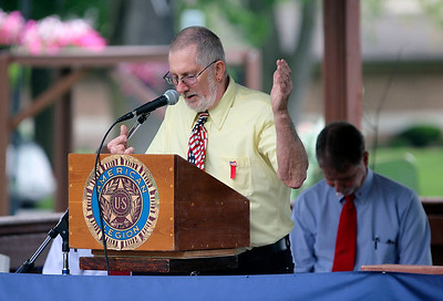 JOHN KLINE | THE GOSHEN NEWS Middlebury American Legion Post 210 member Albert Mitchell provides the invocation during the Memorial Day service at Memorial Park in downtown Middlebury Monday morning.