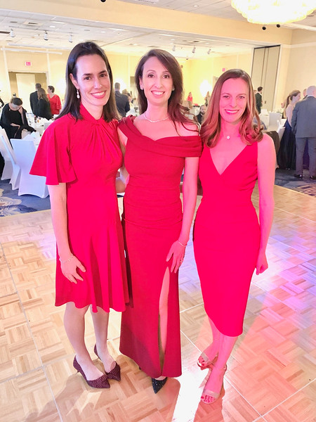 Ladies in red, from left, Jenn Smagula of Westford, Alyssa Nazzaro of Dracut and Heather Curley of Westford