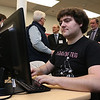 Chris Boudreau, 23, of Hudson N.H. a student in the cybersecurity class on the Lowell campus works in the new lab as many gather for a ribbon cutting to open the lab. SUN/JOHN LOVE
