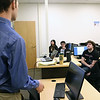 Students in the cybersecurity class on the Lowell campus listen to their Professor Ryan Fried in the new lab during class just after a ribbon cutting to open the new lab on Monday morning. SUN/JOHN LOVE