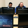 Parth Patel, 20, from Woburn and Christopher Linscott, 27, from Lowell students in the cybersecurity class on the Lowell campus work in the new lab as many gather for a ribbon cutting to open the lab. SUN/JOHN LOVE