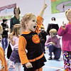 From left, Jackson Kamisky, 2, of Middleton and sister Camille, 4, along with their cousin, Allison Kane, 3, of Danvers, dance and sing along to the music of Judy Pancoast while attending the 25th Annual Middleton Pumpkin Festival Saturday morning. Photo by Deborah Parker/October 24, 2009