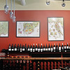 RYAN HUTTON/ Staff photo<br /> Detailed maps of Spain, France, Italy and California show where all diffrent types of wine come hang on the walls of Vinum Wine Shop in Middleton.