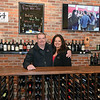 RYAN HUTTON/ Staff photo<br /> Vinum Wine Shop owners Samantha and John Miller stand in their Middleton shop.