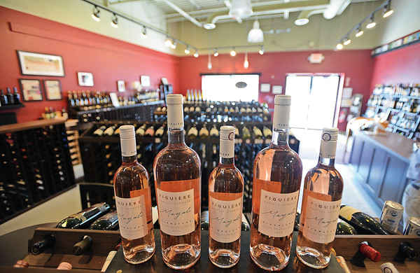 RYAN HUTTON/ Staff photo<br /> Vinum Wine Shop in Middleton stocks 250 types of wine, including Figuiere Magali Rose.