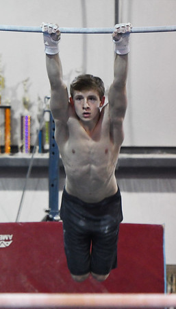 YellowJackets Gym Sam Roache practices his bar routine. <br /> <br /> Photo by JoeBrownPhotos.com