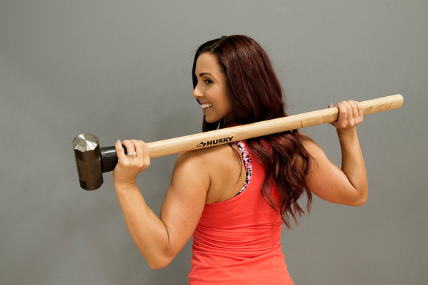 JIM VAIKNORAS/Staff photo Janelle Nicolo poses  at Body Ambition with a sledgehammer, which is used to pound truck tires.