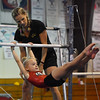 YellowJackets coach Jana Mowers works with a young student on the bars.<br /> <br /> Photo by JoeBrownPhotos.com