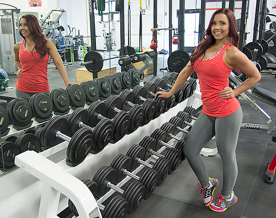 JIM VAIKNORAS/Staff photo Janelle Nicolo  poses amoung t free weights  at Body Ambitions.