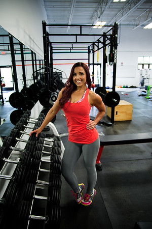 JIM VAIKNORAS/Staff photo Janelle Nicolo  poses amoung  free weights  at Body Ambitions.