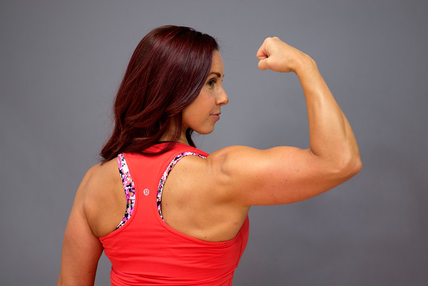 JIM VAIKNORAS/Staff photo Janelle Nicolo shows off the contours of her arm at Body Ambitions,