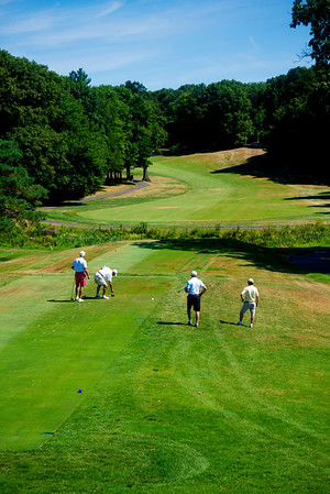 JIM VAIKNORAS/Staff photo A foursome tees of on the 9th hole, a 376 yard par 4, at Fercroft.