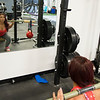 JIM VAIKNORAS/Staff photo Janelle Nicolo  does squats with kettlebells  at Body Ambitions.