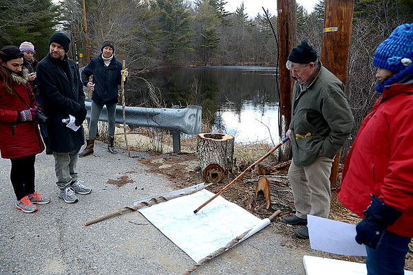 JIM VAIKNORAS/Staff photo Biologist Pike Messenger goes over the route and points out landmarks before The Middleton Stream Team 21st hike winter hike at Prichard's Pond.