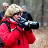 JIM VAIKNORAS/Staff photo Pam Hartman of Middleton takes photographs during The Middleton Stream Team 21st hike winter hike at Prichard's Pond.