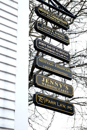 JIM VAIKNORAS/Staff photo Signs at the Estey Tavern in Middleton