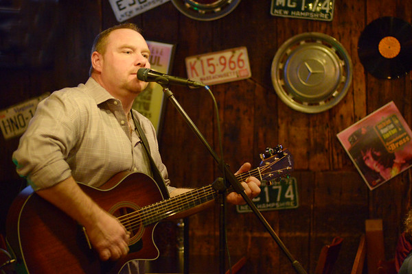JIM VAIKNORAS/Staff photo Musician Joe Savio performs to a full house Wednesday night at Maggie's Farm in Middleton