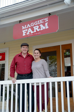 JIM VAIKNORAS/Staff photo Maggie's Farm in Middleton owner Mark McDonough and general manager Laura Balestraci on the front porch of the restaurant.
