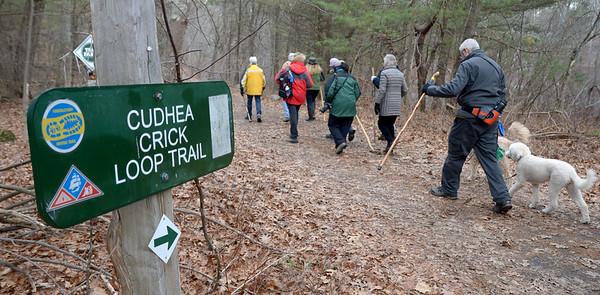 JIM VAIKNORAS/Staff photo Hikers walk along Cudhea Crick Loop Trail  at Prichard Pond during The Middleton Stream Team 21st hike winter hike.