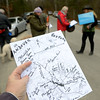 JIM VAIKNORAS/Staff photo Hikers consult maps of the route  before The Middleton Stream Team 21st hike winter hike at Prichard's Pond.