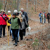 JIM VAIKNORAS/Staff photo Hikers walk along Cudhea Crick Loop Trail  at Prichard Pond during The Middleton Stream Team 21st hike winter hike.