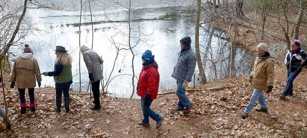 JIM VAIKNORAS/Staff photo Hikers walk along Cudhea Crick Loop Trail  at Prichard's Pond during The Middleton Stream Team 21st hike winter hike.