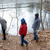 JIM VAIKNORAS/Staff photo Hikers walk along Cudhea Crick Loop Trail  at Prichard's Pond during The Middleton Stream Team 21st hike winter hike.