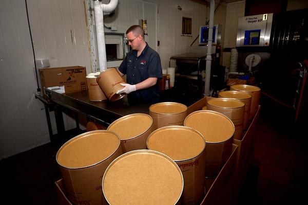 JIM VAIKNORAS/Staff photo  Employee Tim Felix of North Reading fills 3 gallion buckets with ice cream at Richardson's.