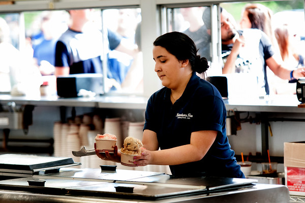 JIM VAIKNORAS/Staff photo Jenny Fernandez of Lynn who is a student at Umass Amherst  serves ice cream at Richardson's