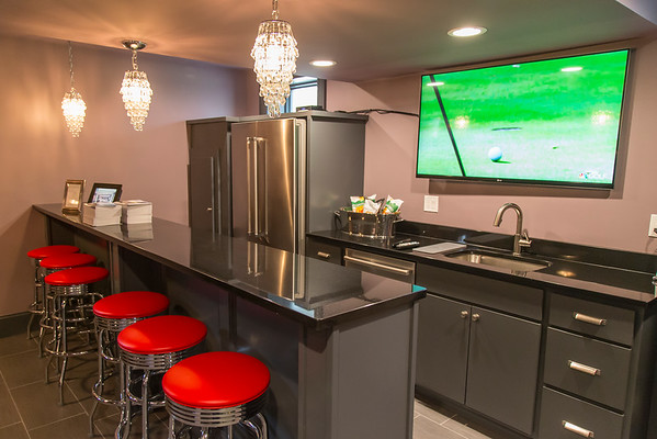 PARKER FISH/ Photo. The basement of this home at 26 Arrowhead Farms Road has been renovated into a an entertainment and recreational area with a bar, standing shuffle board table, and in-home theatre. 5/21/16