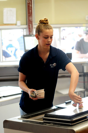 JIM VAIKNORAS/Staff photo Kelsey O'Brien of Middleton who is a student at the University of Alabama serves up ice cream at Richardson's.