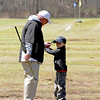 JIM VAIKNORAS/Staff photo  Chris Costa works with his golf student Kenny McCann 5, of Boxford on his grip and backswing posture  at  a golf clinic Middleton Golf Course.