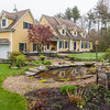 PARKER FISH/ Photo. This home, located at 8 Great Pond Drive, showcases a beautiful water feature in the front yard. 5/21/16