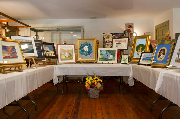 JOE DIFAZIO/ Paintings for sale at Middleton Art Association's annual art fair at the Middleton Historical Society. May 14, 2016