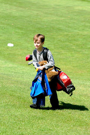 JIM VAIKNORAS/Staff photo  Nick Manley, 7, of Peabody carries his bag back to the clubhouse after his lessons at Middleton Golf Course.