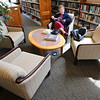KEN YUSZKUS/Staff photo.       Elaine Olden sits and reads in the Adult Lounge at Middleton's Flint Public Library .    05/18/16