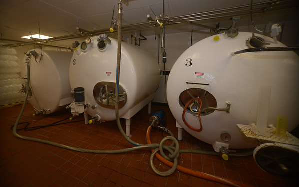 JIM VAIKNORAS/Staff photo  Large holding tanks at Richardson's in Middleton where cream , sugar and flavorings wait to be turned into ice cream.